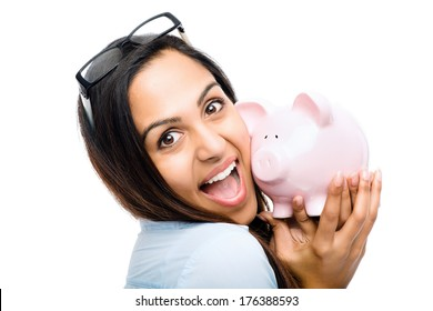 Indian businesswoman holding piggy bank on white background