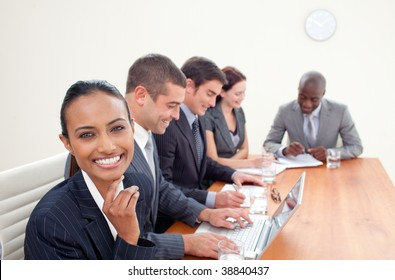 Indian businesswoman in a meeting smiling at the camera