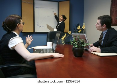Indian businesswoman presenting to her colleagues during a meeting