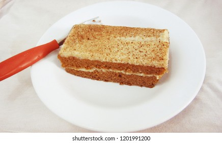 Indian cake in a plate near a fork
