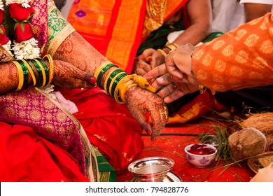 Indian candid wedding photography .focus on hands .couple performed rituals of hindu tradition .