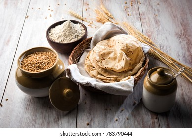 Indian Chapati / Fulka or Gehu Roti with wheat grains in background. It's a Healthy fiber rich traditional North/South Indian food, selective focus