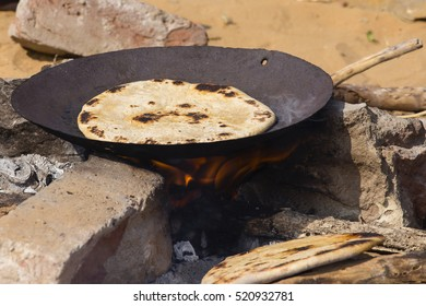 Indian chapatti on fire, Pushkar, India Close up