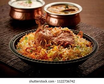 Indian chicken biryani with curry in handi