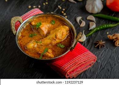 Indian chicken curry or kadai chicken in a copper serving bowl