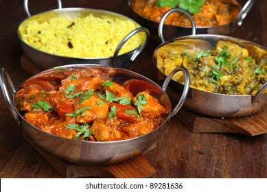 Indian chicken jalfrezi with rice and vegetable curry.