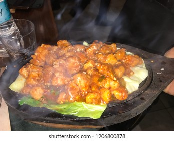 Indian chicken sizzler with hot sauce.