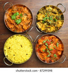 Indian chicken and vegetable curries with pilau rice.