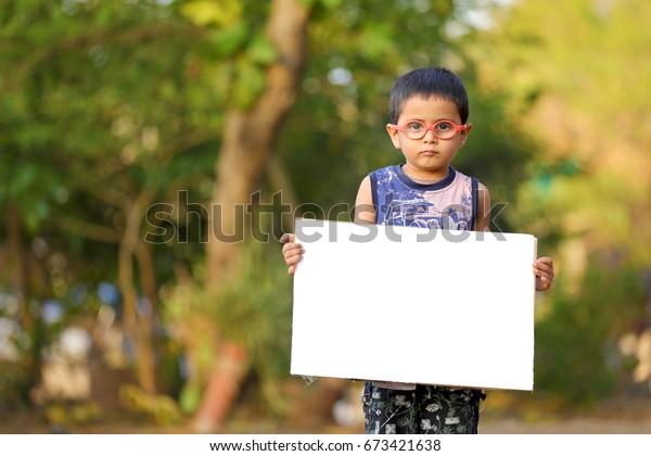 Indian child on eyeglass holding white board in hand Buy