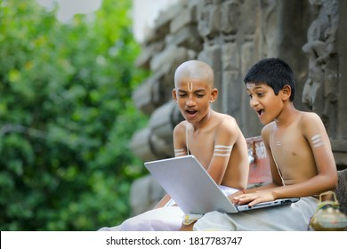 indian child using laptop , learn from home concept