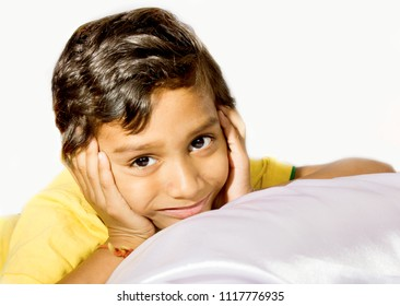 Indian child in yellow t-shirt