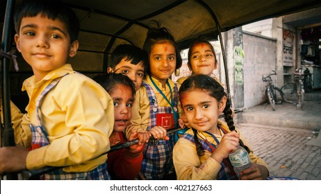 Indian children in yellow uniform going home from school in a Rickshaw. 07, March 2012, Kanpur, India.