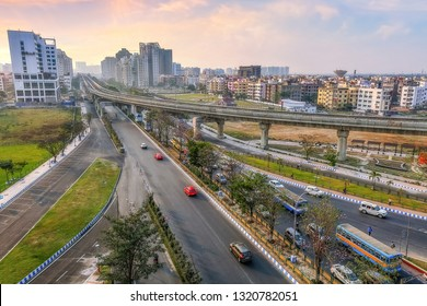 Indian cityscape aerial view with buildings roads and over bridge at sunset. Photograph shot at Newtown Rajarhat area of Kolkata India