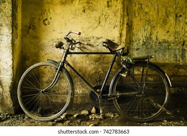 Indian classic bicycle parked in an yellow alley, Kochi city, Kerala State, India
