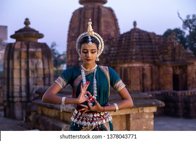 Indian classical Odissi dancer posing with the mudra katakamukha at mukteswar temple, Bhubaneswar,odisha, India