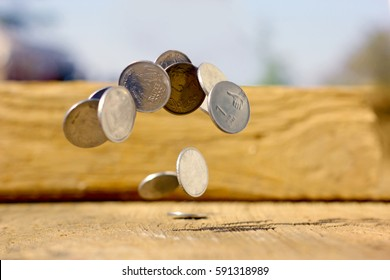 Indian coin  bouncing in air