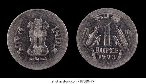 The Indian coin on the black background