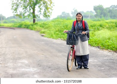 Indian college girl with bicycle