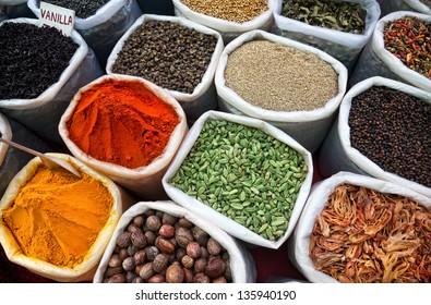 Indian colored spices at Anjuna flea market in Goa, India