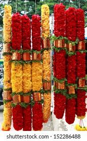 Indian colorful flower garlands for sale at market