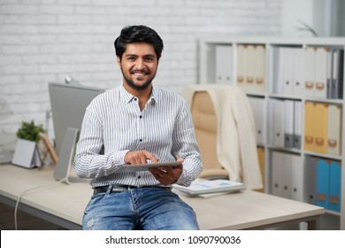 Indian It company manager using application on tablet computer