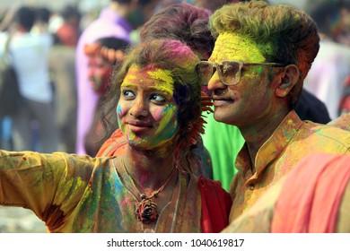 Indian Couple Celebrating Holi.  Basanta Utsab 2018 from Shantiniketan, West Bengal, India. Portrait of love birds at Holi celebration.