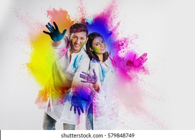 indian couple celebrating holi with colour splash showing colourful or painted palm