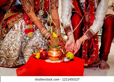 Indian couple during wedding ceremony ritual closeup