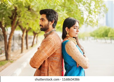 Indian couple fighting. Man and woman turning their back to one another