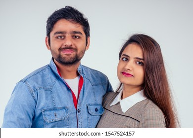 indian couple in love posing at studio white background