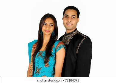 Indian couple in traditional wear. Isolated on white background.