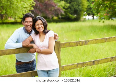 Indian Couple Walking In Countryside