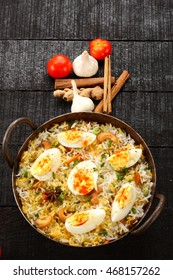 Indian cuisine -delicious egg biriyani,Selective focus photograph,served with ginger garlic and spices,