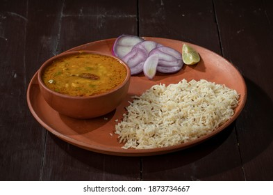 Indian Cuisine Jeera Rice With Dal Tadka Also Know As Cumin Rice on Vintage Wooden Background