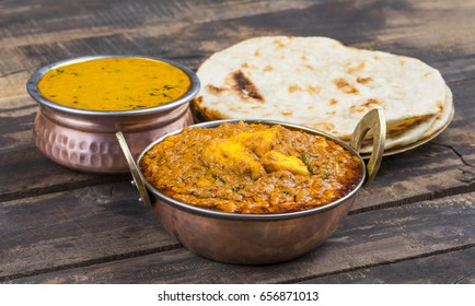 Indian Cuisine Kadai Paneer Served With Dal Makhani or Tandoori Also Know as Kadhai Paneer or Karahi Paneer is an Indian Dish of Marinated Paneer Cheese Served in a Spiced Gravy on Wooden Background
