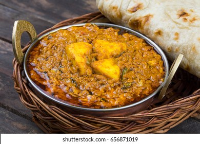 Indian Cuisine Kadai Paneer Served With Tandoori Also Know as Kadhai Paneer or Karahi Paneer is an Indian Dish of Marinated Paneer Cheese Served in a Spiced Gravy on Vintage Wooden Background