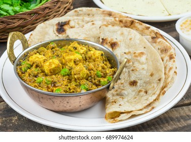 Indian Cuisine Mattar Paneer is a Vegetarian North Indian Dish Consisting of Peas And Paneer in a Tomato Based Sauce, Spiced with Garam Masala. It is often Served with Indian type of Tandoori Roti