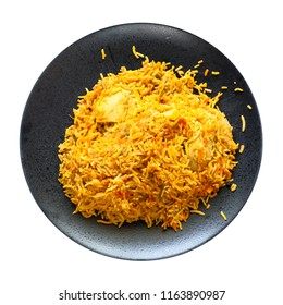 Indian cuisine - Murg Sindh Biriyani spicied chicken pulao cooked with potato in DUM style in tandoor on black plate isolated on white background