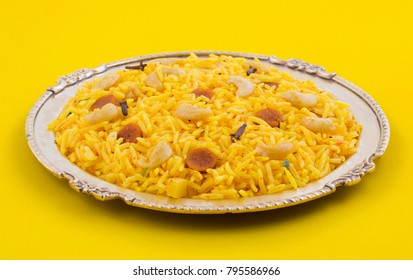 Indian Cuisine Pulao Also Know as Pulav, Vegetarian Biryani, Veg Pulav, Vegetable Pulav, Biriyani or Vegetable Rice is a Spicy Rice Dish Prepared By Cooking Rice with Various Vegetables And Spices