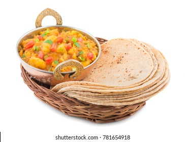 Indian Cuisine Spicy Fried Aloo Also Know as Potato Fry, Potato Curry, Aloo Masala or Alu Masala Served with Indian Bread, Roti or Chapati isolated on White Background