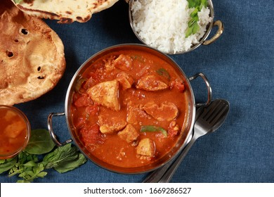 Indian Cuisine Tandoori Chicken Masala with Naan Bread and side dishes