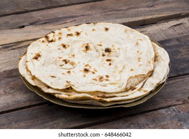 Indian Cuisine Tandoori Roti Served in Plate Also Called Chapati, Flatbread, Naan or Nan Bread on Wooden Background