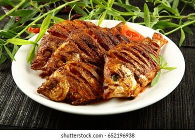 Indian cuisine-Spicy and delicious fried fish in coconut oil,