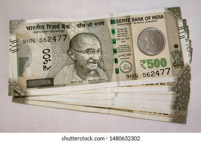 Indian currency note arranged with coin