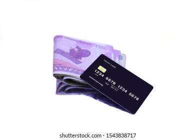 Indian currency note with credit and debit cards on the white backgrounds