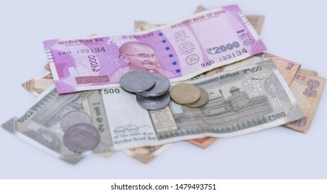 Indian currency note Two thousand, five hundred rupee note with coins and cents