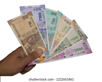 Indian Currency Notes in hand in playing cards shot with White / Isolated background
