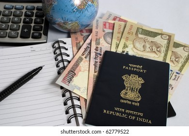 indian currency with passport and calculator, concept for making travel budget