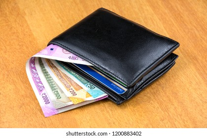 Indian Currency and a purse.