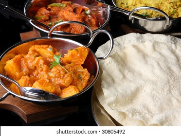 Indian curries with poppadoms